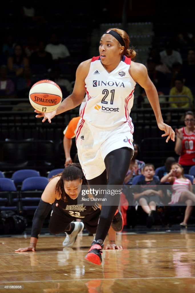 Tianna Hawkins #21 of the Washington Mystics drives against the San Antonio Stars at the Verizon Center on June 29, 2014 in Washington, DC.