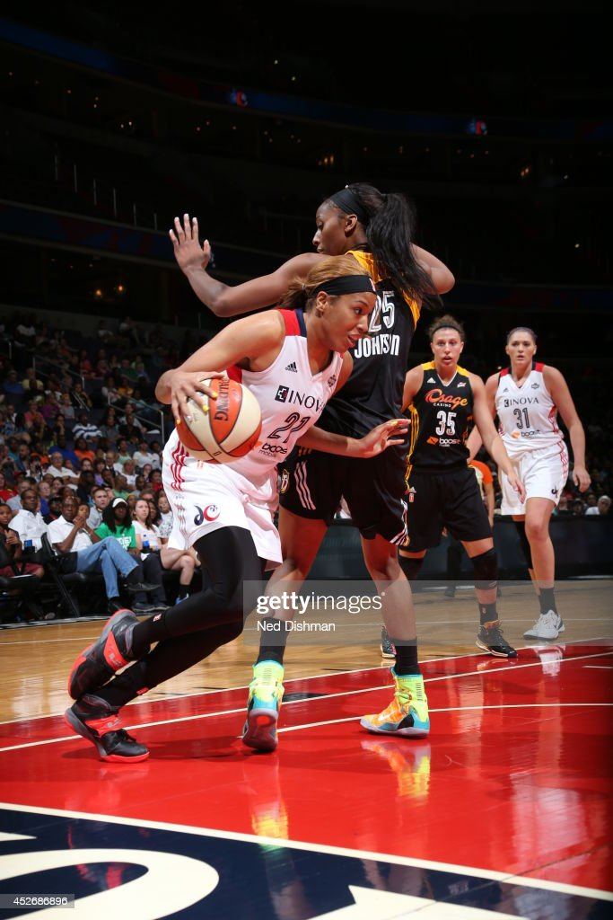 <a gi-track='captionPersonalityLinkClicked' href=/galleries/search?phrase=Tianna+Hawkins&family=editorial&specificpeople=6559085 ng-click='$event.stopPropagation()'>Tianna Hawkins</a> #21 of the Washington Mystics drives against the Tulsa Shock at the Verizon Center on July 25, 2014 in Washington, DC.