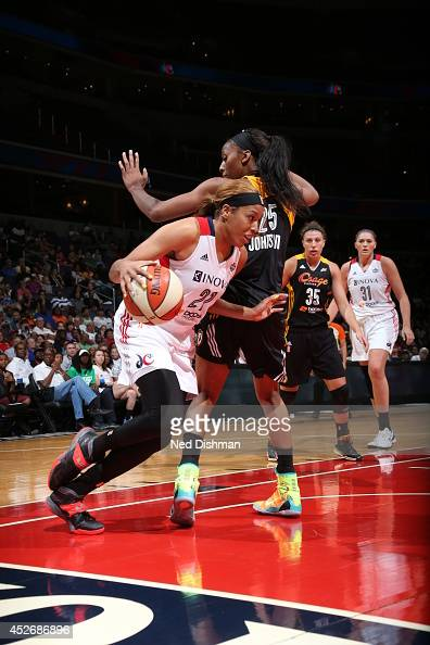Tianna Hawkins of the Washington Mystics drives against the Tulsa Shock at the Verizon Center on July 25 2014 in Washington DC NOTE TO USER User...