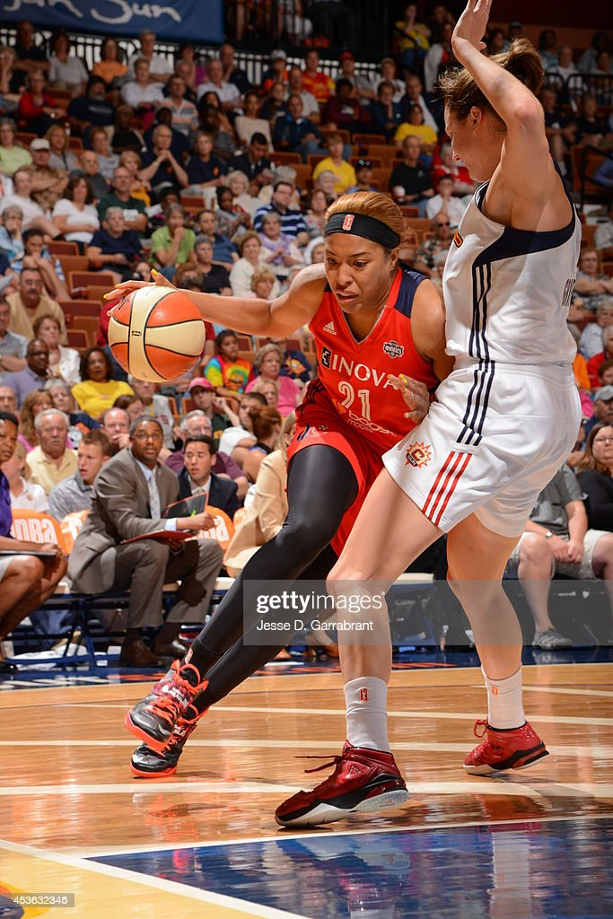 Tianna Hawkins #21 of the Washington Mystics drives to the basket against Kelsey Griffin #5 of the Connecticut Sun during the game on August 10, 2014 at the Mohegan Sun in Uncasville, Connecticut.