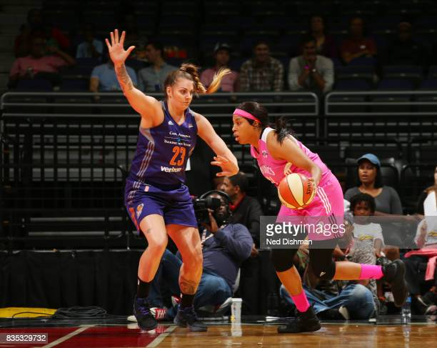 Tianna Hawkins of the Washington Mystics drives to the basket against Cayla George of the Phoenix Mercury on August 18 2017 at the Verizon Center in...
