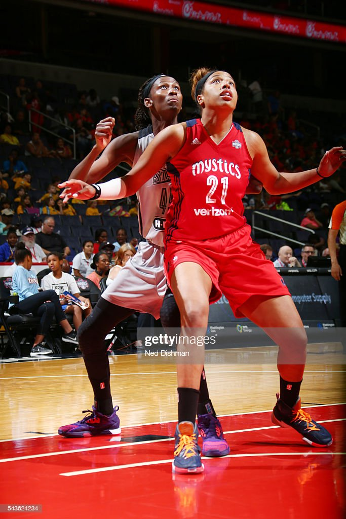 Tianna Hawkins #21 of the Washington Mystics fights for position against Astou Ndour #45 of the San Antonio Stars on June 29, 2016 at the Verizon Center in Washington, DC.