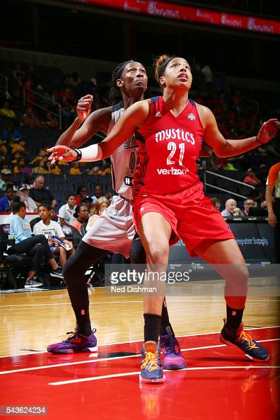 Tianna Hawkins of the Washington Mystics fights for position against Astou Ndour of the San Antonio Stars on June 29 2016 at the Verizon Center in...