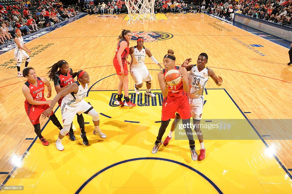Tianna Hawkins of the Washington Mystics grabs a rebound against the Indiana Fever during the game on May 23 2014 at Bankers Life Fieldhouse in...