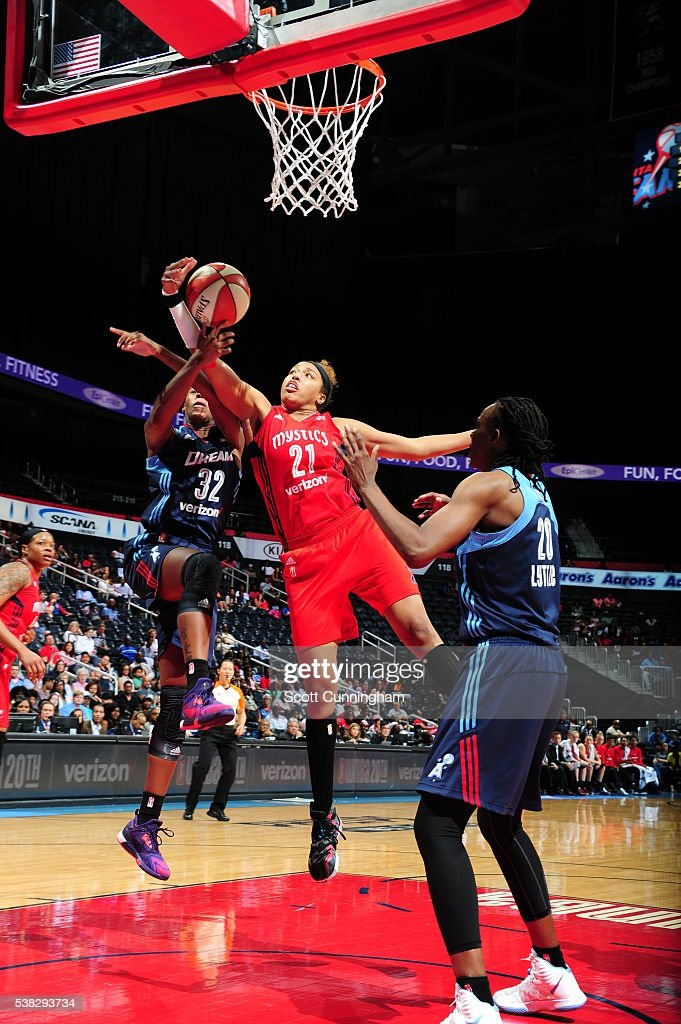 <a gi-track='captionPersonalityLinkClicked' href=/galleries/search?phrase=Tianna+Hawkins&family=editorial&specificpeople=6559085 ng-click='$event.stopPropagation()'>Tianna Hawkins</a> #21 of the Washington Mystics grabs the rebound against the Atlanta Dream on June 5, 2016 at Philips Arena in Atlanta, Georgia.