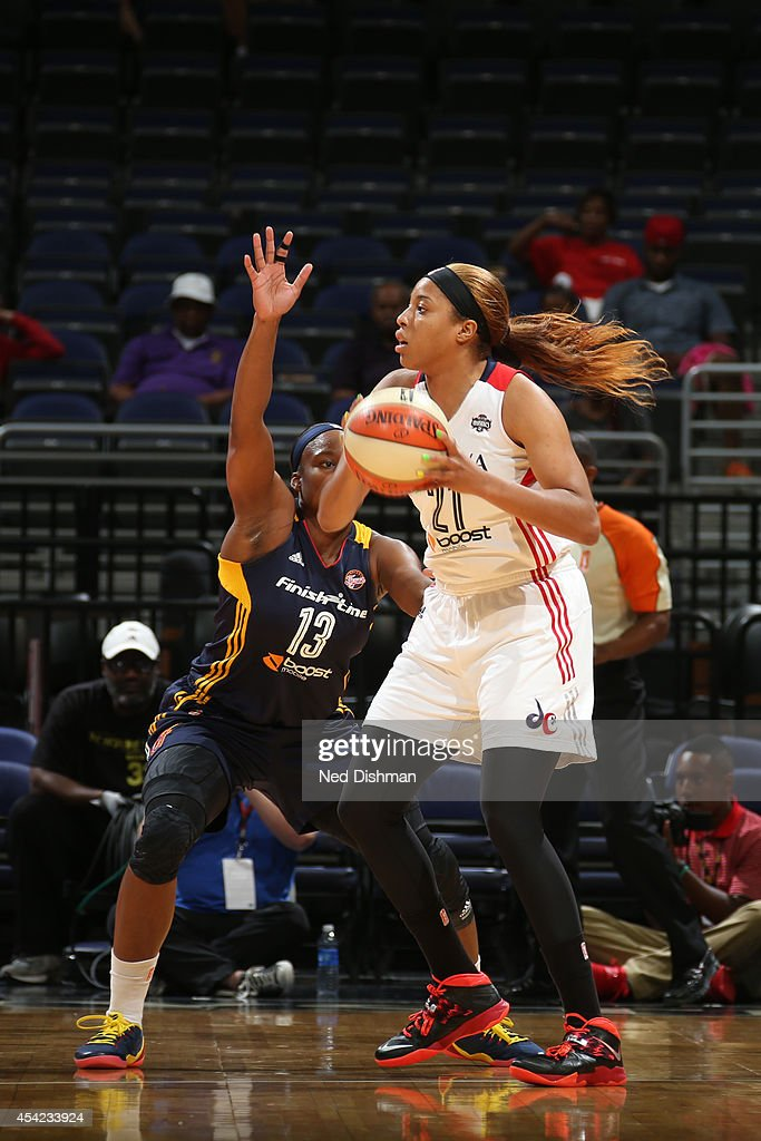 Tianna Hawkins #21 of the Washington Mystics handles the ball against Karima Christmas #13 of the Indiana Fever in Game Two of the Eastern Conference Semifinals during the 2014 WNBA Playoffs on August 23, 2014 at the Verizon Center in Washington, DC.