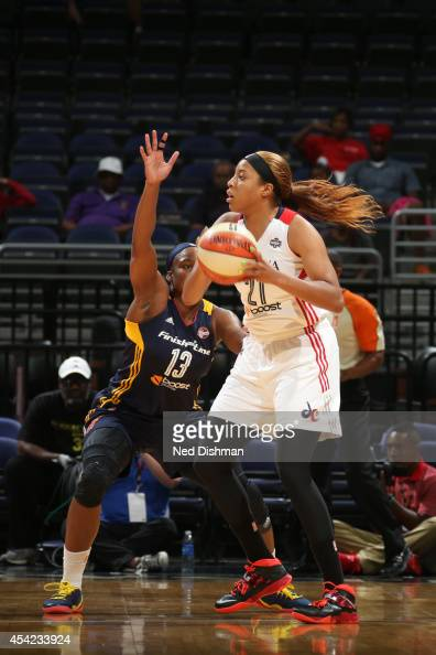 Tianna Hawkins of the Washington Mystics handles the ball against Karima Christmas of the Indiana Fever in Game Two of the Eastern Conference...