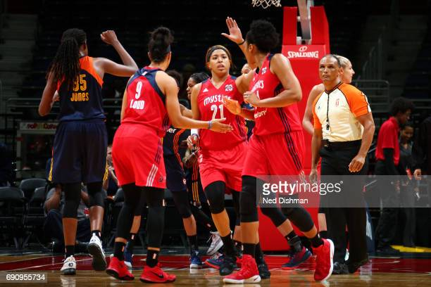 Tianna Hawkins of the Washington Mystics high fives her teammates during the game against the Connecticut Sun on May 31 2017 at the Verizon Center in...
