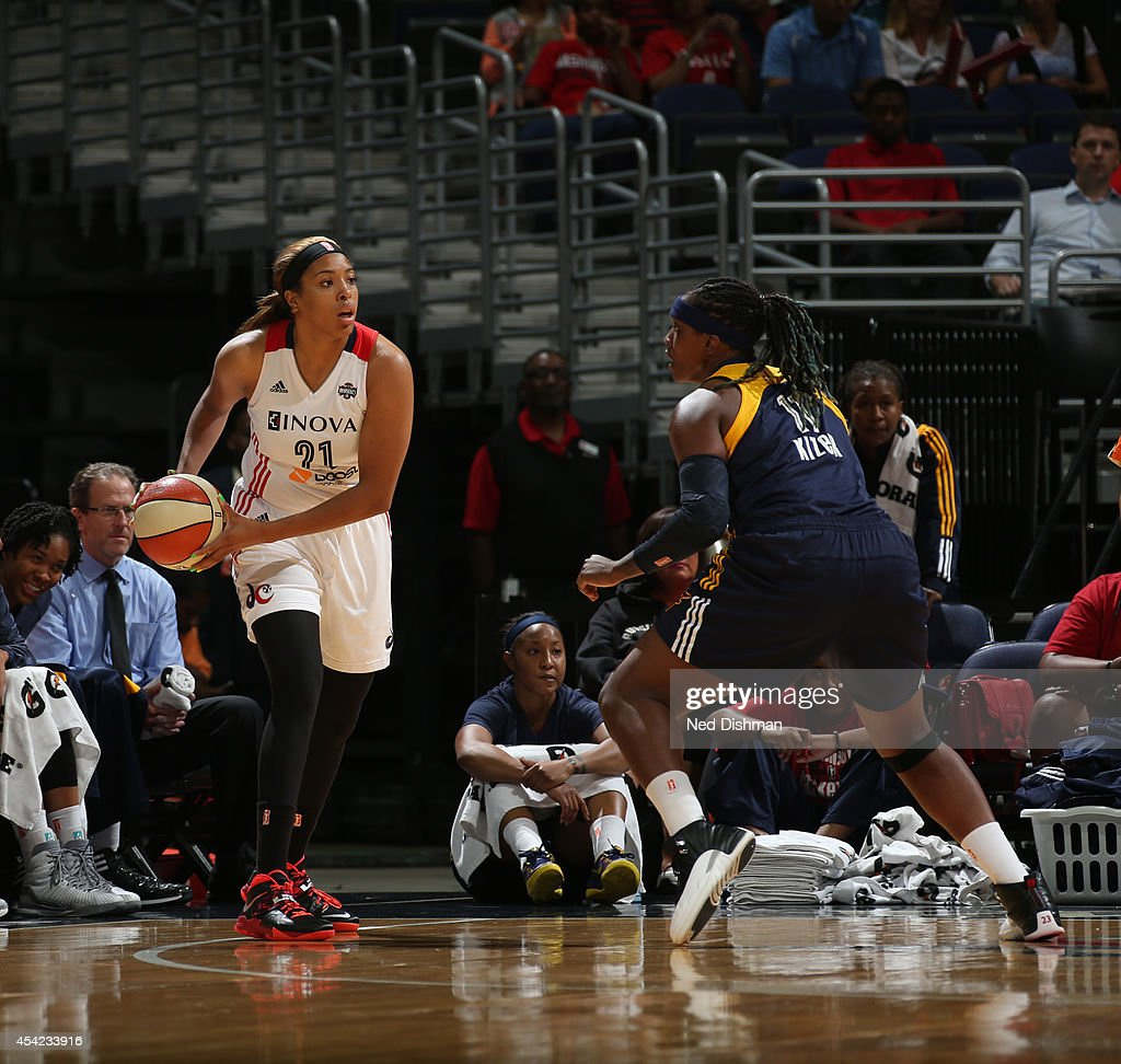 <a gi-track='captionPersonalityLinkClicked' href=/galleries/search?phrase=Tianna+Hawkins&family=editorial&specificpeople=6559085 ng-click='$event.stopPropagation()'>Tianna Hawkins</a> #21 of the Washington Mystics looks to pass the ball against Lynetta Kizer #11 of the Indiana Fever in Game Two of the Eastern Conference Semifinals during the 2014 WNBA Playoffs on August 23, 2014 at the Verizon Center in Washington, DC.
