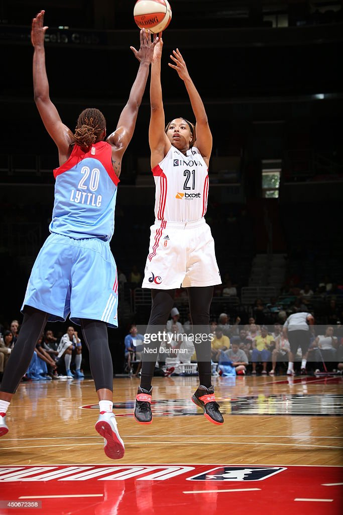 Tianna Hawkins #21 of the Washington Mystics shoots against Sancho Little #20 of the Atlanta Dream at the Verizon Center on June 15, 2014 in Washington, DC.
