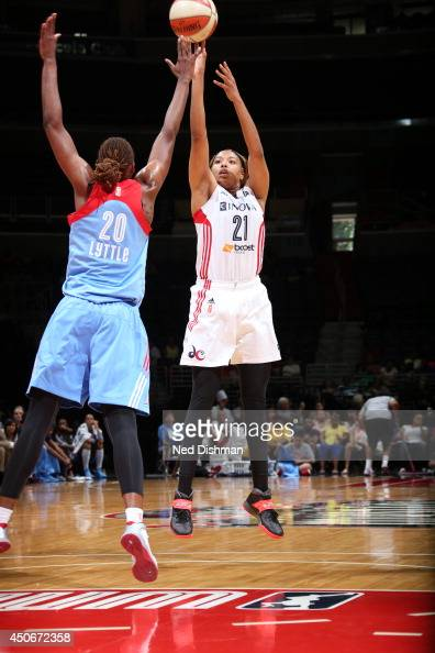 Tianna Hawkins of the Washington Mystics shoots against Sancho Little of the Atlanta Dream at the Verizon Center on June 15 2014 in Washington DC...