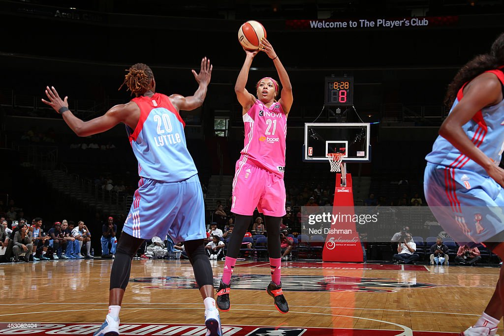 Tianna Hawkins of the Washington Mystics shoots the ball against Sancho Lyttle of the Atlanta Dream at the Verizon Center on July 27 2014 in...