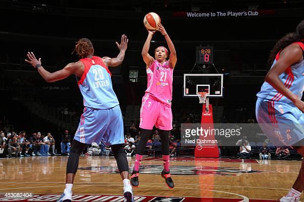 Tianna Hawkins of the Washington Mystics shoots the ball against Sancho Lyttle of the Atlanta Dream at the Verizon Center on July 27 2014 in...