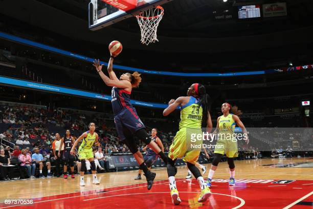 Tianna Hawkins of the Washington Mystics shoots the ball during a game against the Dallas Wings on June 18 2017 at the Verizon Center in Washington...