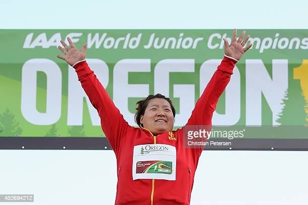 Tianqian Guo of China celebrates on the podium after winning the women's shot put final during day four of the IAAF World Junior Championships at...
