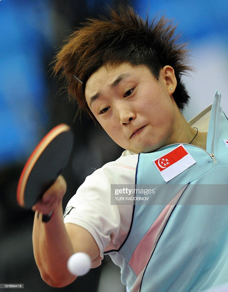 Tianwei Feng of Singapore returns a service to Jiaduo Wu of Germany during the women's semi final at the 2010 World Team Table Tennis Championships in Moscow on May 29, 2010.