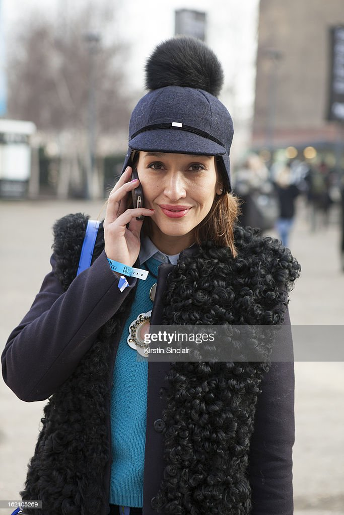 Tiany Kiriloff wearing Joshep coat, Cos jumper, high hat and a Marni necklace on day 4 of London Womens Fashion Week Autumn/Winter 2013 on February 18, 2013 in London, England.