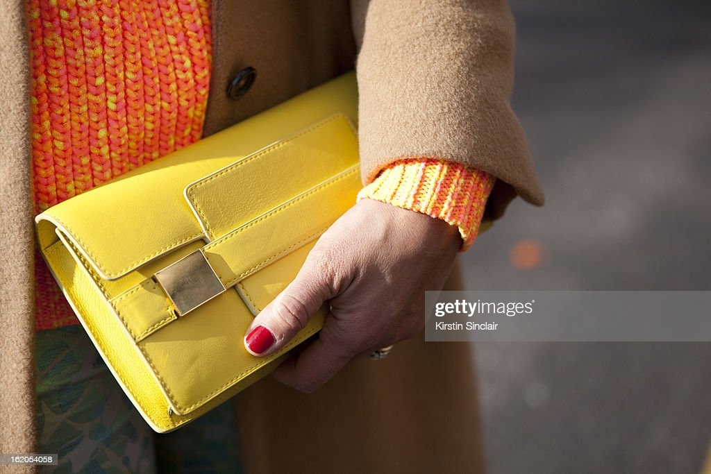 Tiany Kiriloff wears a Delvaux clutch, Jill Sanders jacket and Kenzo sweater on day 3 of London Womens Fashion Week Autumn/Winter 2013 on February 17, 2013 in London, England.