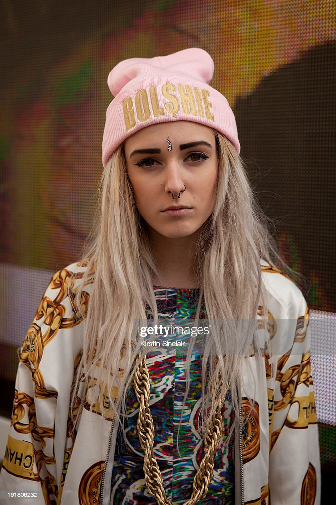 Tiar Johnston Fashion student wearing a Bolshie hat, Chanel jacket, Asos jump suit and a chain from Asos on day 1 of London Womens Fashion Week Autumn/Winter 2013 on February 15, 2013 in London, England.