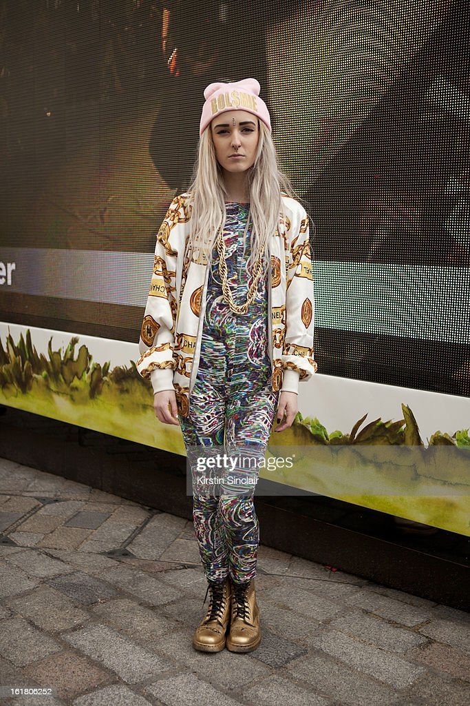 Tiar Johnston Fashion student wearing a Bolshie hat, Chanel jacket, Asos jump suit, Doc Martens boots, chain from Asos on day 1 of London Womens Fashion Week Autumn/Winter 2013 on February 15, 2013 in London, England.