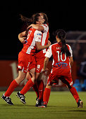 Tiarn Powell of Adelaide United celebrates with teammates after she scored a goal during the round 12 WLeague match between Adelaide and Melbourne at...