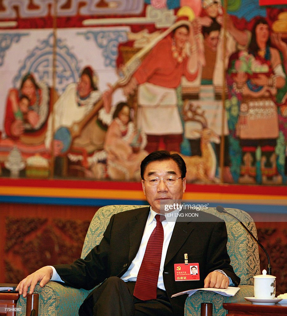 Tibet Communist Party chief Zhang Qingli sits in front of a Tibetan wall painting as he attends the Tibet delegation meeting at the 17th Communist Party Congress at the Great Hall of the People in Beijing, 16 October 2007. China is 'strongly indignant' at attempts to interfere in its internal affairs, the top official for Tibet said 16 October ahead of a meeting between US President George W. Bush and the Dalai Lama.