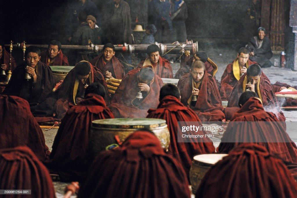 Tibet, Lhasa, monks chanting at Jokhang temple : Stock Photo