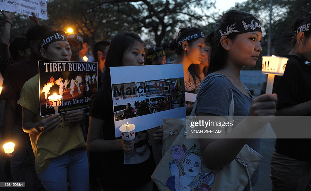 Tibetan activists hold candles as members of the Regional Tibetan Youth Congress (RTYC) take part in a candlelight vigil during protest rally in Hyderabad on March 10, 2013.The protest marked the 54th anniversary of the Tibetan national uprising, the 1959 rebellion against China's rule in Tibet. AFP PHOTO/ Noah SEELAM