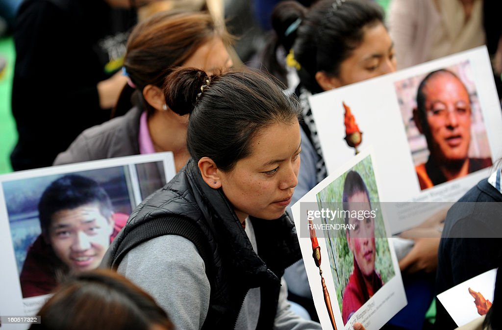 Tibetan activists hold photographs of Tibetans who have self-immolated during a protest rally in New Delhi on February 2, 2013. The Tibetan government in exile launched a Solidarity with Tibet Campaign 2013, as Tibetans continue to self-immolate calling for freedom in Tibet. AFP PHOTO/RAVEENDRAN