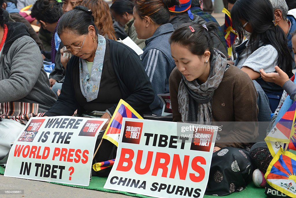 Tibetan activists hold placards during a protest rally in New Delhi on February 1, 2013. The Tibetan government in exile launched a Solidarity with Tibet Campaign 2013, as Tibetans continue to self-immolate calling for freedom in Tibet. Thousands of Tibetans are on a protest in the Indian capital as part of a renewed drive to bring global pressure on China and highlight a string of self-immolations in their homeland.