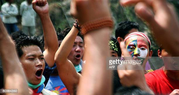 Tibetan activists in exile shout antiChinese slogans at the West BengalSikkim interstate border in Rangpo on March 26 2008 after police denied them...