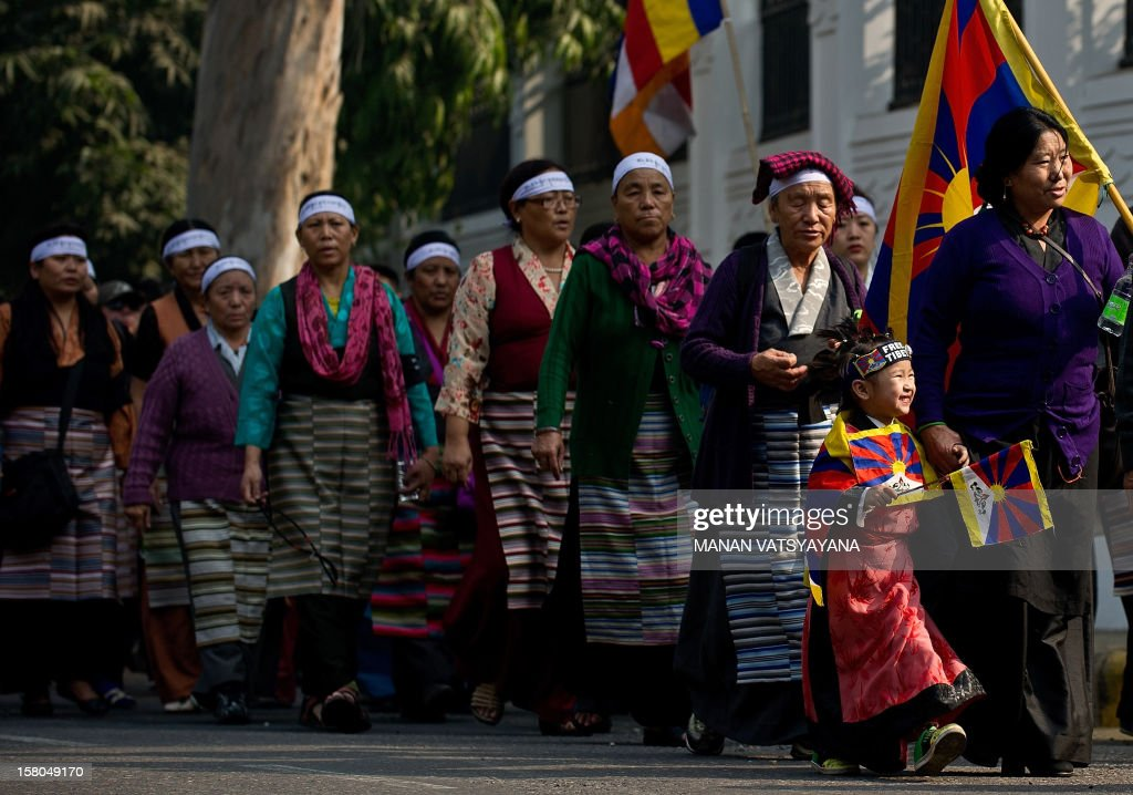 Tibetan activists in-exile take part in a protest in New Delhi on December 10, 2012, to mark World Human Rights Day. A 16-year-old Tibetan girl has died after setting herself on fire, Chinese state media said December 10, in an area that has become a flashpoint for protests against Beijing's rule.
