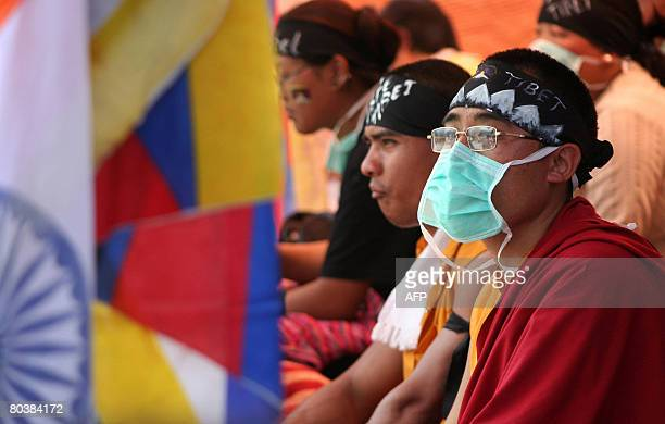 Tibetan activists sit on hunger strike at the West BengalSikkim interstate border in Rangpo on March 26 after police denied marchers entry into...