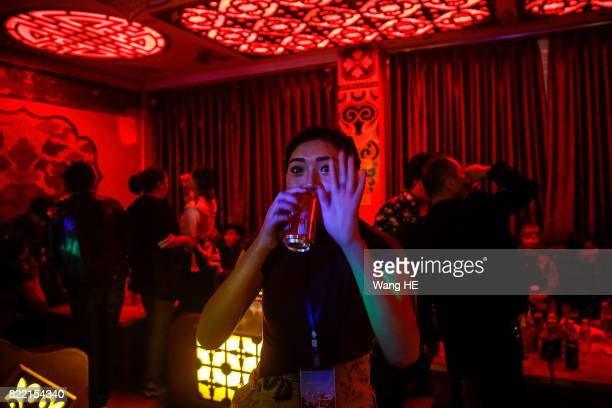 A Tibetan bar girl is seen in Tibetan Bar on July 22 2017 in Litang County southwest of Garze Tibetan Autonomous Prefecture Sichuan China Litang Town...