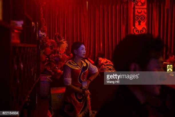 A Tibetan bar girl waits for her guests in Tibetan Bar on July 22 2017 in Litang County southwest of Garze Tibetan Autonomous Prefecture Sichuan...