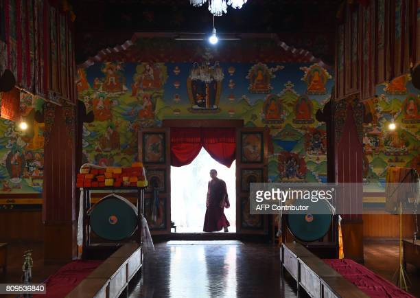 A Tibetan Buddhist monk arrives to take part in a procession to mark the birthday of spiritual leader the Dalai Lama at Boudhanath Stupa in the...