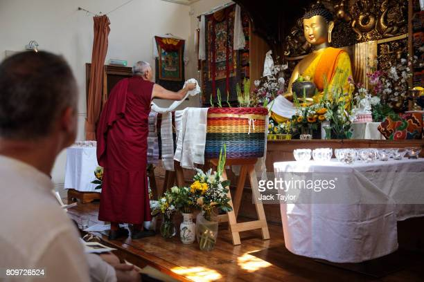 Tibetan Buddhist monk Geshe Tashi lays funeral tributes over the willow eco coffin of Jon Underwood at the Jamyang Buddhist Centre on July 6 2017 in...