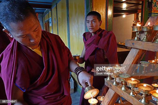 A Tibetan Buddhist monk lights a butter lamp at Dongzhulin Monastery during the observation of annual rites in commemoration of Tsonkhapa Benzilan...
