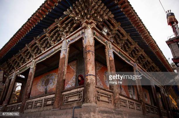 Tibetan buddhist monk walk around in the courtyard of the Kumbum Monastery on April 23 2017 in Xining Qinghai Province Kumbum was founded in 1583 in...