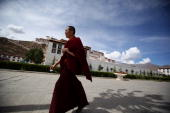 Tibetan Buddhist monk walks on the Potala Palace square on June 19 2009 in Lhasa Tibet Autonomous Region China Traditionally Lhasa is the seat of the...