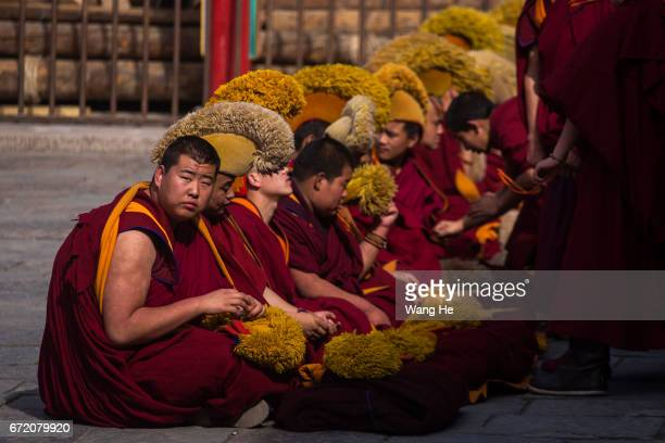 Tibetan Buddhist monks during a debate about Buddhist related issues in the courtyard of the Kumbum Monastery on April 23 2017 in Xining Qinghai...