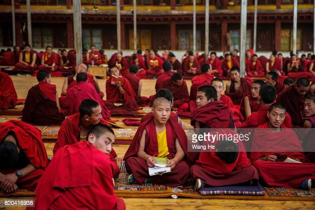 Tibetan Buddhist monks during a debate about Buddhist related issues in the Long youth Cole Temple on July 21 2017 in Litang County Ganzi Tibetan...