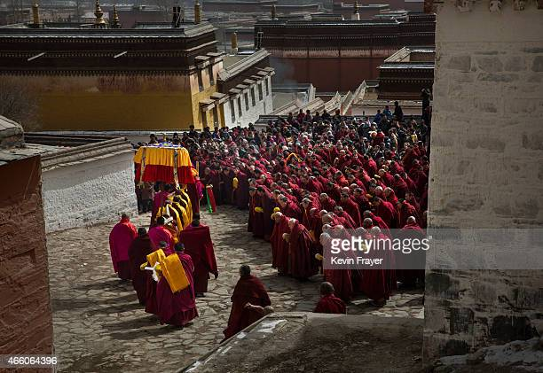 Tibetan Buddhist monks gather during Monlam or the Great Prayer rituals on March 5 2015 at the Labrang Monastery Xiahe County Amdo Tibetan Autonomous...