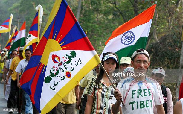 Tibetan Buddhist monks in exile and demonstrators march at the start of a peace rally from Salugara area on the outskirts of Siliguri on March 20...