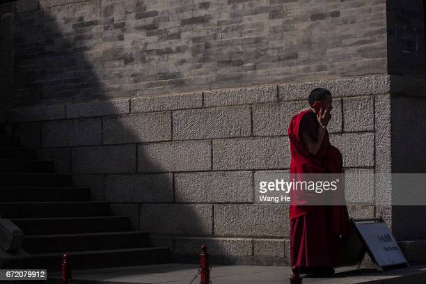 Tibetan buddhist monks make call in the courtyard of the Kumbum Monastery on April 23 2017 in Xining Qinghai Province Kumbum was founded in 1583 in a...