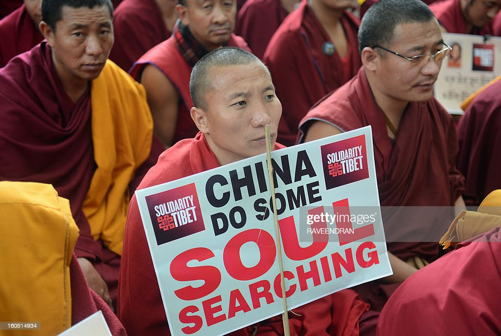 Tibetan Buddhist monks, nuns and activists attend a protest rally in New Delhi on February 2, 2013. The Tibetan government in exile launched a Solidarity with Tibet Campaign 2013, as Tibetans continue to self-immolate calling for freedom in Tibet. AFP PHOTO/RAVEENDRAN
