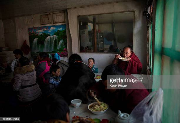 Tibetan Buddhist Monks of the Gelug or Yellow Hat order eats lunch with others during Monlam or the Great Prayer rituals on March 3 2015 at the...