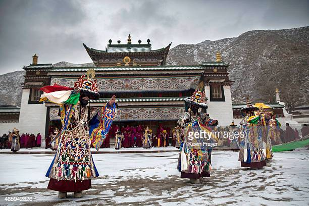 Tibetan Buddhist monks perform a black hat dance during Monlam or the Great Prayer rituals on March 4 2015 at the Labrang Monastery Xiahe County Amdo...