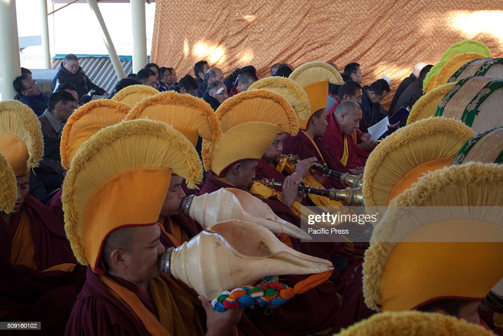 Tibetan Buddhist monks playing musical instrument during the 1st day of Tibetan new year 'Losar' at Tsugla Khang Temple. Tibetan Buddhist Monks chant the Tibetan Mantras during the 1st day of Tibetan new year 'Losar' at Tsugla Khang Temple. Hundred of Tibetan Buddhist Monks and Tibetan in exile including members of the Tibetan parliament (Kasag) participated in this prayer.
