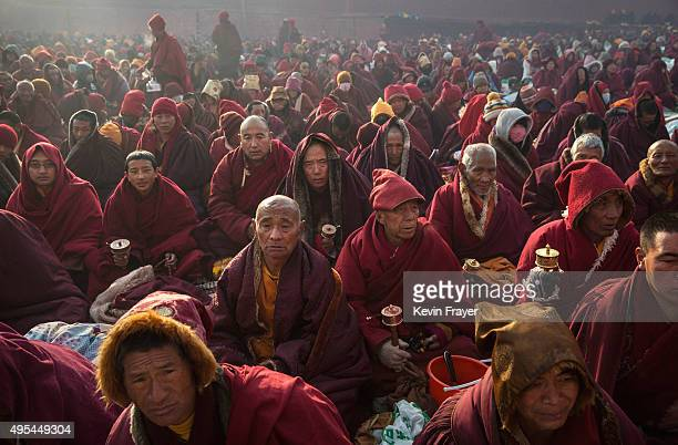 Tibetan Buddhist monks sit in subzero temperatures during a morning chanting session at the annual Bliss Dharma Assembly at the Larung Wuming...